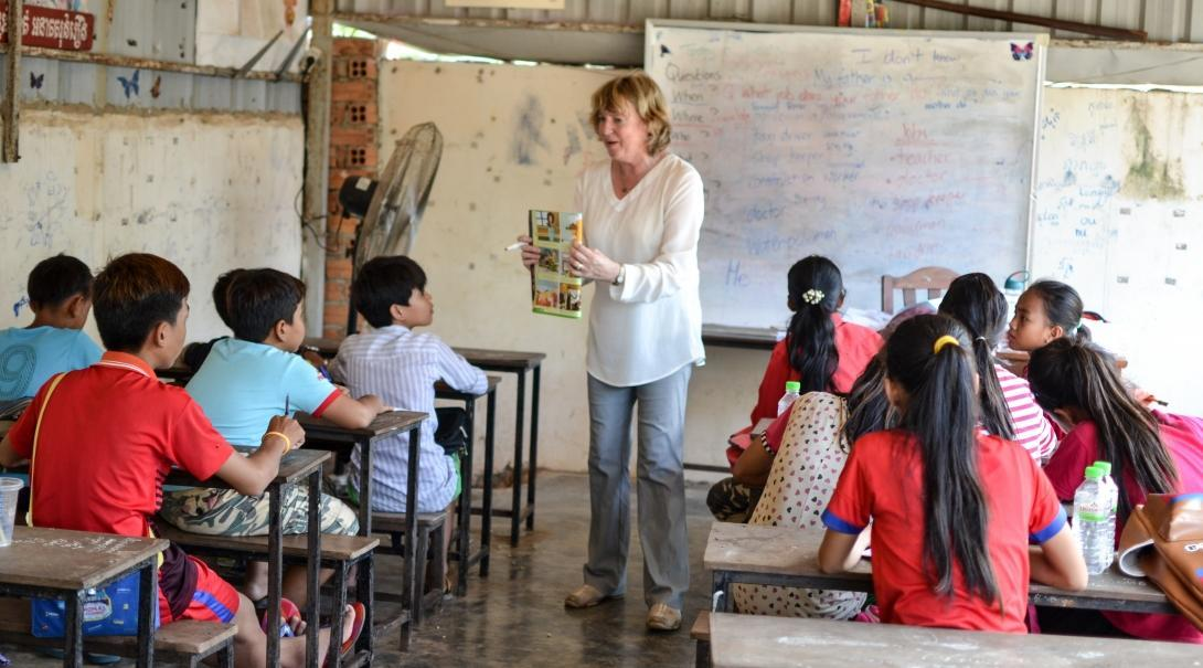 An English book is read to the students by a Projects Abroad volunteer teaching in Cambodia